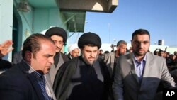 Anti-American cleric Moqtada al-Sadr, center, is surrounded by bodyguards in the Shiite city of Najaf, Iraq, 06 Jan 2011