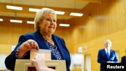 Norwegian Prime Minister Erna Solberg, leader of the Conservative Party, casts her vote in the 2021 parliamentary election at Skjold School in her home town, in Bergen, Norway, September 13, 2021. (NTB/Hakon Mosvold Larsen via Reuters)