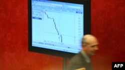 FILE - A Russian broker is seen inside Russia's MICEX stock market in Moscow.