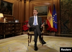 Spain's King Felipe VI delivers his traditional Christmas address at Zarzuela Palace in Madrid, Spain, December 23, 2017 in this photo released Dec. 24, 2017.