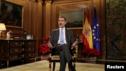 Spain's King Felipe VI delivers his traditional Christmas address at Zarzuela Palace in Madrid, Spain, December 23, 2017 in this photo released December 24, 2017.