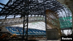 The Fisht Olympic Stadium is pictured under construction for the 2014 Winter Olympic Games in Sochi, Aug. 20, 2013.