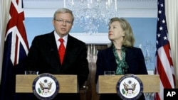 Australia's Foreign Minister Kevin Rudd talks as Secretary of State Hillary Rodham Clinton looks on during a meeting at the State Department in Washington, Monday, May 2, 2011. (AP Photo/Luis M. Alvarez)