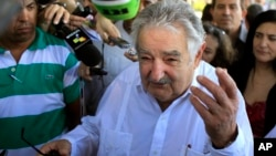 FILE - Uruguay's President Jose Mujica speaks to journalists after laying flowers at a monument of his nation's hero Jose Gervasio Artigas Arnal in Havana, Cuba, July 25, 2013.