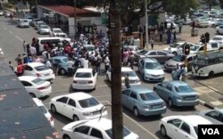 Uber drivers clash with meter taxi drivers.
