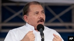 FILE - Nicaragua's President Daniel Ortega speaks during a ceremony marking the 34th anniversary of the withdrawal to Masaya, in Managua, July 5, 2013.