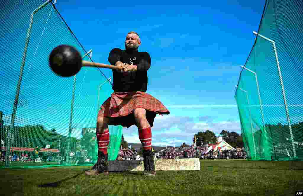 A competitor takes part in the throwing the hammer event during the annual Braemar Gathering in Braemar, central Scotland, Sept. 7, 2019.