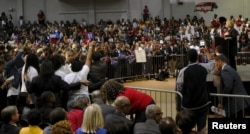 """U.S. Democratic presidential candidate Hillary Clinton speaks at the """"African Americans for Hillary"""" rally as protesters from """"Black Lives Matter"""" (L) interrupt her speech at Clark Atlanta University in Atlanta, Georgia October 30 2015."""