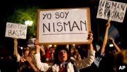Demonstrator holds sign that says 'I am Nisman' in Spanish during protest outside the government house, Plaza de Mayo, Buenos Aires, Argentina, Jan. 19, 2015.