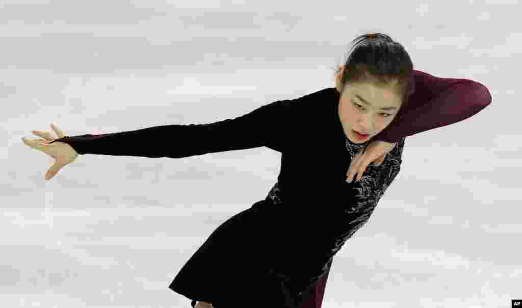 Yuna Kim of South Korea skates during a practice session at the Iceberg Skating Palace during the 2014 Winter Olympics, Sochi, Russia, Feb. 20, 2014.