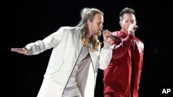 """FILE - Tyler Hubbard, right, and Brian Kelley, of Florida Georgia Line, perform """"Meant to Be"""" at the 53rd annual Academy of Country Music Awards in Las Vegas, April 15, 2018. The duo, along with Carrie Underwood and Jason Aldean are the leading nominees for the CMT Music Awards with four each."""