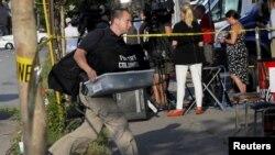 查尔斯顿伊曼纽尔黑人教堂枪击案的两天后,调查人员抵达这个教堂(2015年6月19日)
