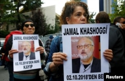FILE - Human rights activists hold pictures of Saudi journalist Jamal Khashoggi during a protest outside the Saudi Consulate in Istanbul, Turkey, Oct. 9, 2018.