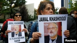 Human rights activists hold pictures of Saudi journalist Jamal Khashoggi during a protest outside the Saudi Consulate in Istanbul, Turkey, Oct. 9, 2018.