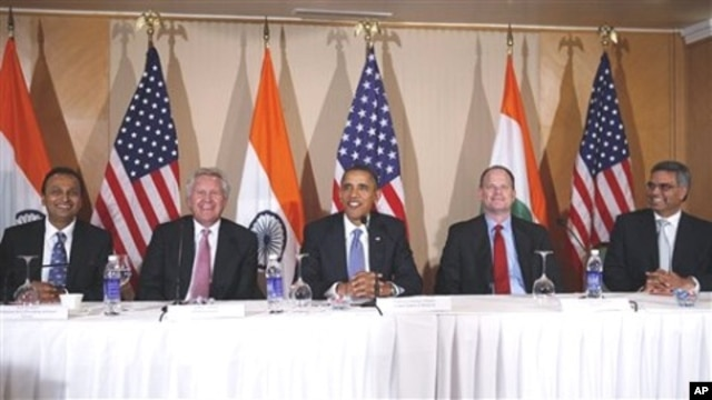 President Barack Obama seated with, from left to right, Anil Ambani of Reliance Anil Dhirubhai Ambani, General Electric's Jeffrey Immelt, Boeing's Christopher Chadwick, Bhupendra Khansagra of India's Spice Jet, as he holds a roundtable discussion with CEO