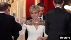 FILE - French First Lady Brigitte Macron attends a state dinner held at the Elysee Palace in Paris, France, March 19, 2018.