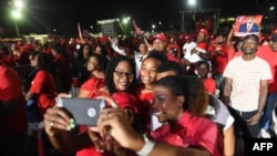 Supporters celebrate the general election victory of Hubert Minnis of Free National Movement, May 10, 2017 in Nassau, Bahamas.