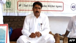 FILE - This photograph taken on July 22, 2010, shows Pakistani surgeon Shakeel Afridi, who was working for CIA to help find Osama bin Laden, attending a Malaria control campaign in Khyber tribal district.