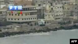 Hình ảnh chụp từ video hôm Chủ Nhật ngày 14/8 của hãng tin Shaam (SHAMSNN) cho thấy xe bọc thép của lực lượng an ninh Syria tại các vị trí ở thành phố cảng Latakia