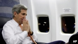 U.S. Secretary of State John Kerry speaks to journalists about his negotiations with Iran upon his arrival from Vienna at Andrews Air Force Base, Md., Jan. 17, 2016.