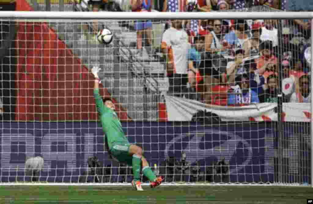 Japan's goalkeeper Ayumi Kaihori tries, but can't save a goal scored by United States' Carli Lloyd during the first half of the FIFA Women's World Cup soccer championship in Vancouver, British Columbia, July 5, 2015.