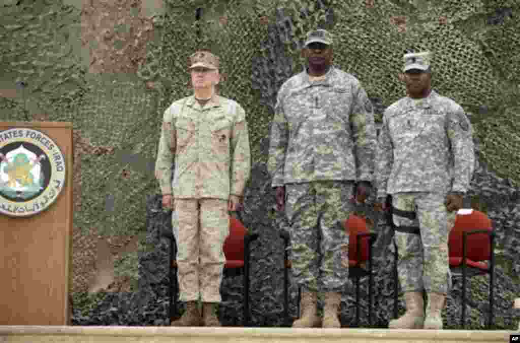 Gen. Lloyd Austin, the top U.S. commander in Iraq, center, stands during ceremonies marking the end of US military mission in Baghdad, Iraq, Thursday, Dec. 15, 2011. After nearly nine years, 4,500 American dead, 32,000 wounded and more than $800 billion,