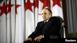 FILE - President Abdelaziz Bouteflika looks on during a swearing-in ceremony in Algiers, Algeria.