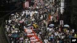 Thousands of people marched in Hong Kong to protest a plan to hold Chinese patriotism classes in schools