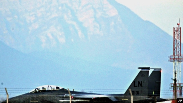 A U.S. Air Force F-15E Strike Eagle fighter jet taxis before taking off from the NATO airbase in Aviano, March 21, 2011