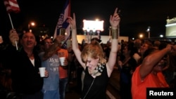 People celebrate after the announcement of the death of Cuban revolutionary leader Fidel Castro in the Little Havana district of Miami, Florida, U.S. November 26, 2016.