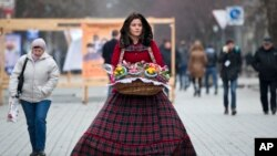 A flower vendor walks downtown Simferopol, Ukraine, March 9, 2014.