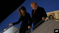 President Donald Trump and first lady Melania Trump alight from Air Force One, after arriving at Orly airport near Paris, Nov. 9, 2018.