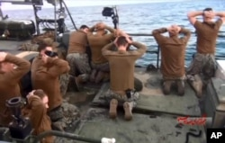 FILE - U.S. Navy sailors detained by the Iranian Revolutionary Guards in the Persian Gulf, Iran, are shown in this photo released by the Iranian state-run IRIB News Agency. Jan. 13, 2016.