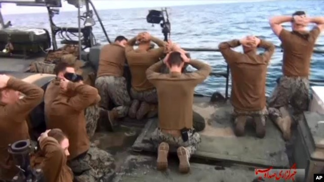 A photo, released by the Iranian state-run IRIB News Agency Jan. 13, 2016, shows the detention of U.S. Navy sailors by the Iranian Revolutionary Guards in Iranian waters of the Persian Gulf.
