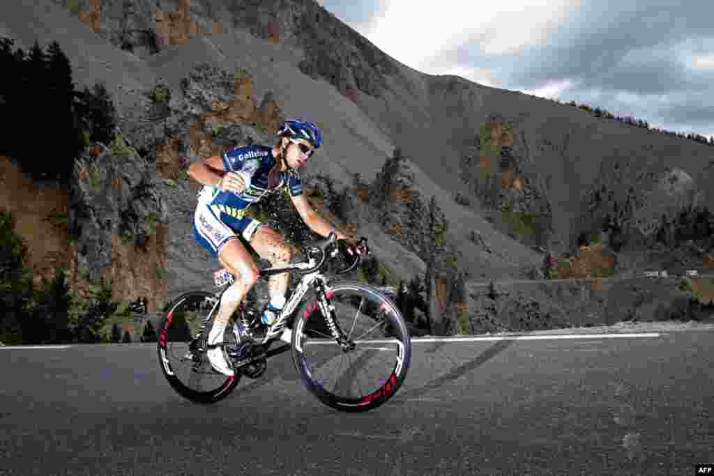 July 21: Johnny Hoogerland of The Netherlands climbs Izoard pass during the 18th stage of the Tour de France cycling race. (AP Photo/Laurent Cipriani)