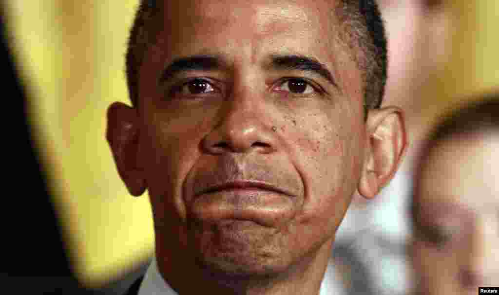 U.S. President Barack Obama speaks about the need for Congress to extend tax cuts for middle class families at the White House in Washington July 9, 2012. REUTERS/Kevin Lamarque (UNITED STATES - Tags: POLITICS)