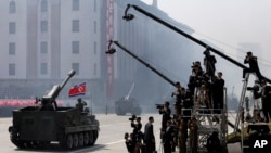 FILE - North Korean artillery pass by North Korean journalists during a military parade in Kim Il Sung Square in Pyongyang, April 15, 2012.