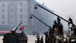 FILE - North Korean artillery pass by North Korean journalists during a parade in Kim Il Sung Square in Pyongyang, April 15, 2012.