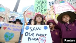 School children take part in the global #ClimateStrike rally, in Brisbane, Australia, March 15, 2019.