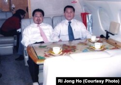 A senior North Korean defector, Ri Jong Ho, right, who oversaw North Korea's overall production and trade while serving at the Office 39 for decades, heads to Pyongyang with Chinese investment tycoon Sam Pa, December 2006.