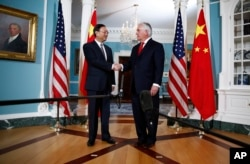 Secretary of State Rex Tillerson shakes hands with Chinese State Councilor Yang Jiechi during a photo opportunity at the State Department in Washington, Feb. 8, 2018.