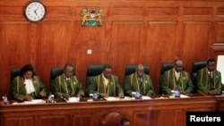 Kenya's Chief Justice Willy Mutunga (3rd L) leads Supreme Court judges (L-R) Njoki Ndung'u, Philip Tunoi, Jackton Ojwang, Mohamed Ibrahim and Smokin Wanjala, in Nairobi, March 30, 2013.
