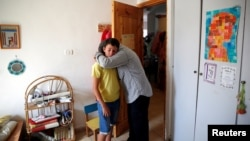 Relatives hug each other at the bedroom of Israeli girl, Hallel Yaffa Ariel, 13, who was killed in a Palestinian stabbing attack in her home in the West Bank Jewish settlement of Kiryat Arba, near the West Bank city of Hebron June 30, 2016.