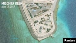 Construction is shown on Mischief Reef in the Spratly Islands, the disputed South China Sea, in this June 19, 2017, satellite image released by CSIS Asia Maritime Transparency Initiative at the Center for Strategic and International Studies (CSIS) to Reuters on June 29, 2017.
