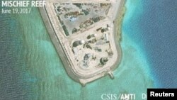 Construction is shown on Mischief Reef in the Spratly Islands, South China Sea, in this June 19, 2017, satellite image released by CSIS Asia Maritime Transparency Initiative at the Center for Strategic and International Studies (CSIS).