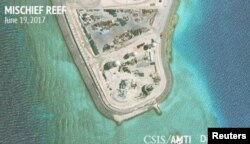 Construction is shown on Mischief Reef in the Spratly Islands, the disputed South China Sea, in this June 19, 2017, satellite image released by CSIS Asia Maritime Transparency Initiative at the Center for Strategic and International Studies (CSIS) to Reuters.