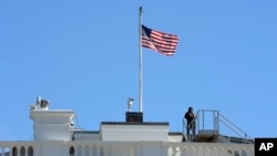 FILE - The U.S. flag flies over the White House in Washington, Nov. 10, 2016.