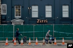 A police cordon and fence are placed outside a Zizzi restaurant near the area where former Russian double agent Sergei Skripal and his daughter were found critically ill following exposure to the Russian-developed nerve agent Novichok in Salisbury, Englan