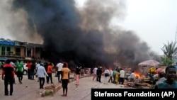 جوس شہر کے بس اڈے کے نزدیک ہونے والے بم دھماکے کے بعد کا منظر