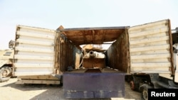 A tank gun hidden inside a truck, made by Islamic State militants, to avoid attack from planes are seen at Federal Police Headquarters after being confiscated in Mosul, Iraq July 13, 2017.